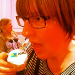Carrie eating an AVG cupcake at Cybher